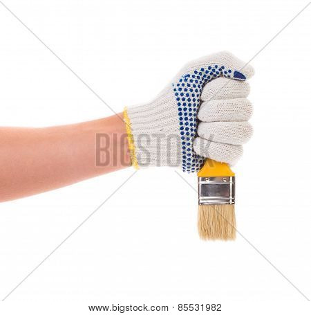Hand in gloves holds brush.
