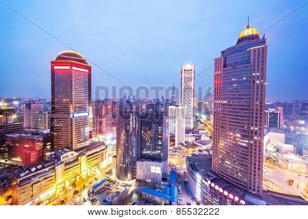skyline and office buildings of modern city nanjing at night.