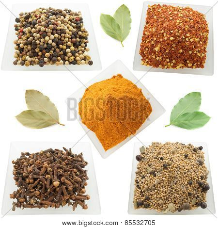 A variety of spices and seasonings on a white background?
