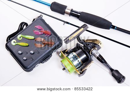 Fishing Rod And Reel With Box For Baits On White.