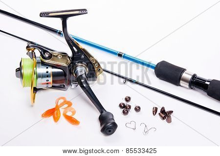 Fishing Rod And Reel With Silicone Baits On White.