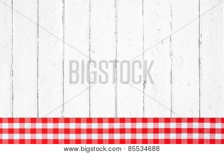 Old red white checked wooden background with fabrics on the frame.