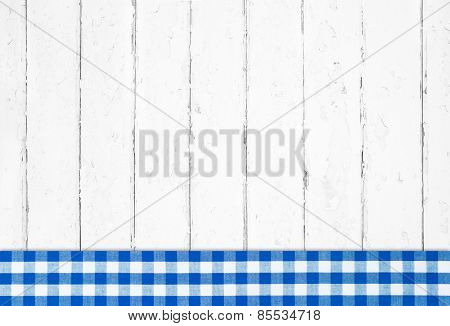 Old blue white checked wooden background with fabrics.