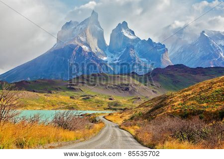 Summer day in the national park Torres del Paine, Patagonia, Chile. Majestic peaks of Los Kuernos over Lake Pehoe
