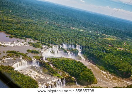The famous Iguazu Falls on the Brazilian-Argentine border. Waterfalls are located in the two national parks - Argentina and Brazil in the dense tropical forests. Picture taken from a helicopter