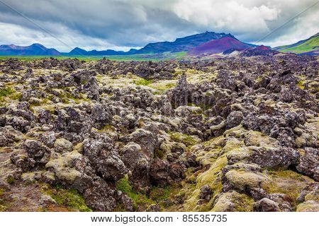 Cloud Iceland in the summer. Lava fields in the central part of the island