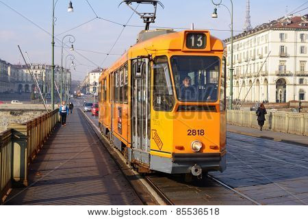 TURIN, ITALY - JANUARY 11, 2013: Tram on the bridge. Such trams are intended for movement on narrow streets of historical part of city
