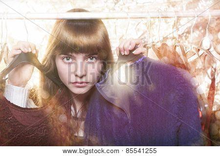 Beautiful Teenage Girl And Her Wardrobe In Backlit