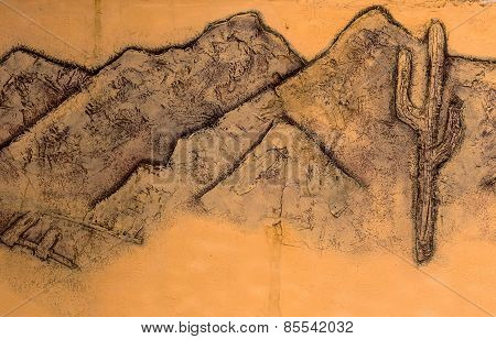 Stone Facade Fresco Wall Decoration. Bas-relief Image Cowboy Indians And Desert Landscapes Of Americ
