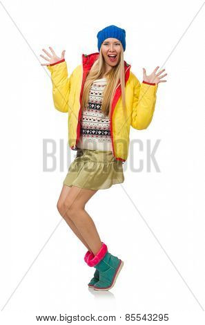 A girl in bright winter clothes isolated on white