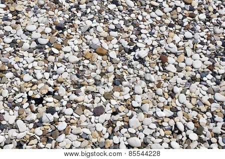 Smooth Pebbles On Beach
