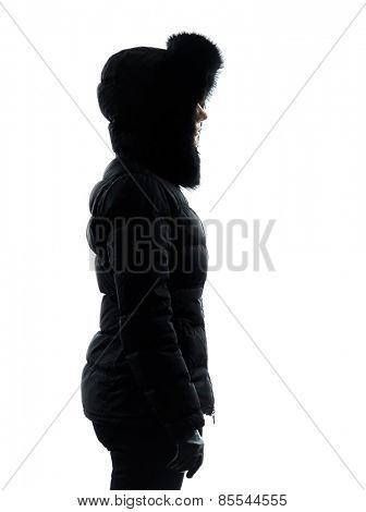 one woman in winter coat serious standing profile silhouette on white background