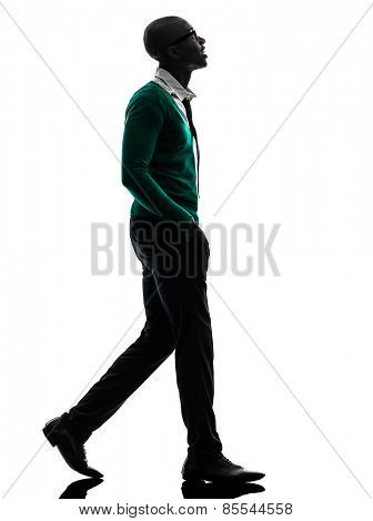 one african black man walking looking up in silhouette studio on white background