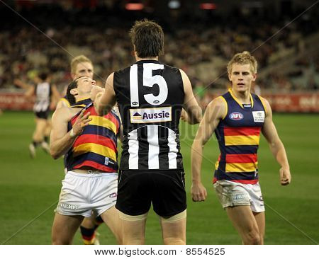 Melbourne - August 21:  Collingwood's Leigh Brown (c) Shows His Strength During Collingwood's Win Ov