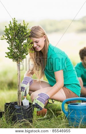 Pretty blonde gardening for her community on a sunny day