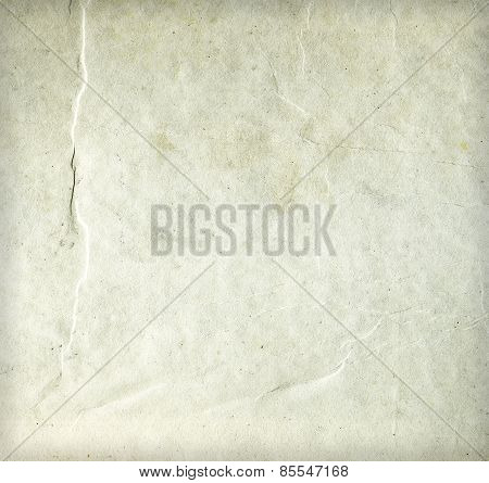 Old wrinkled dirty beige paper sheet