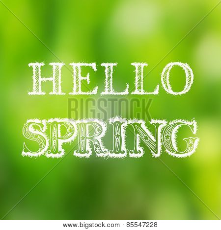 Hello spring hand lettering on blurred background