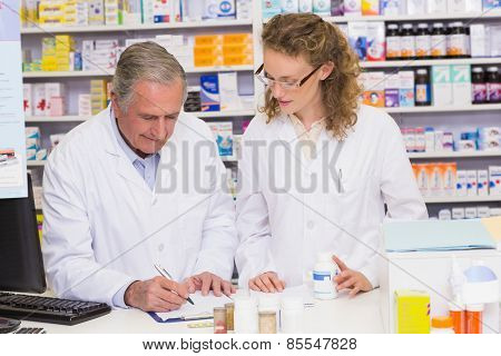 Team of pharmacist looking a medication for a prescription at hospital pharmacy