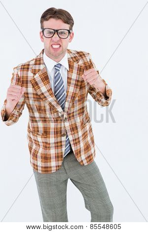 Angry geeky hipster looking at camera on white background
