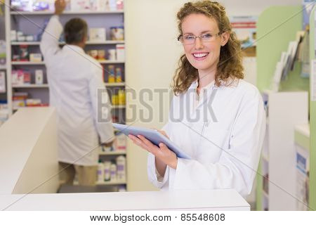 Pharmacist using tablet pc at hospital pharmacy
