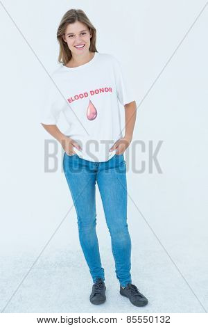 Blood donor with hands in pockets in white background