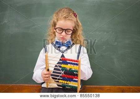 Pupil holding abacus at elementary school