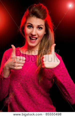 Young happy woman having fan in a discotheque