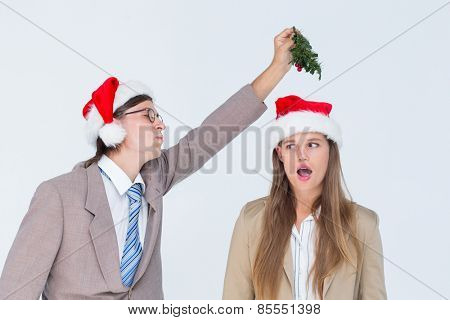 Geeky hipster with mistletoe on white background