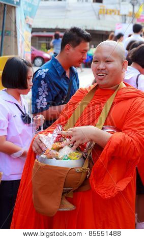 Buddhist Monks Is Given Food Offering From People At The Morning On End Of Buddhist Lent Day