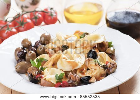 Italian tortellini pasta salad with parsley and green olives