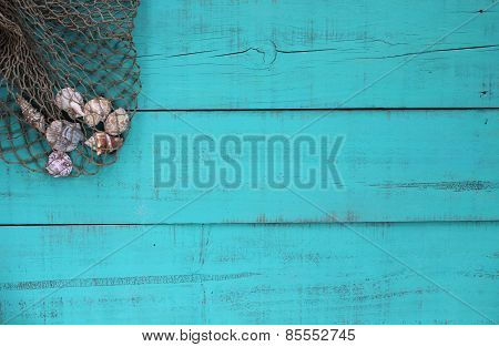 Blank wood beach sign with shells in fish net