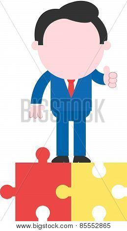 Businessman Top Of Puzzle Pieces