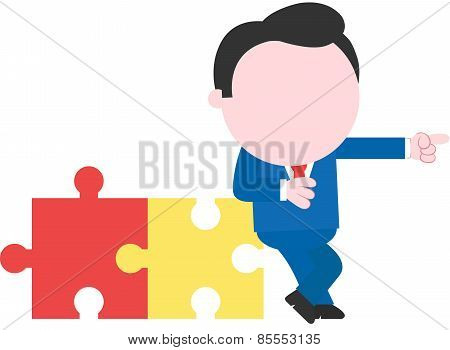 Businessman Leaning On Puzzle Pieces