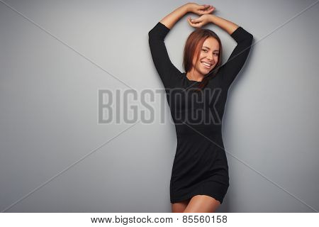 Young mixed race woman on grey background