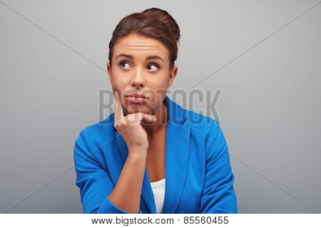 Thoughtful young mixed race woman