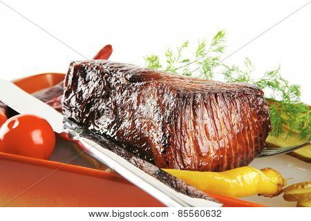 roast beef meat with tomatoes and peppers