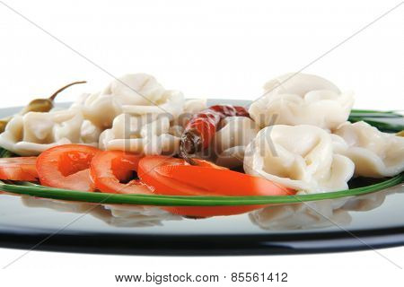 fresh boiled meat dumplings served with chives on black