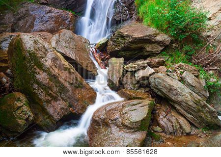 Small Waterfall On A Mountain Rive