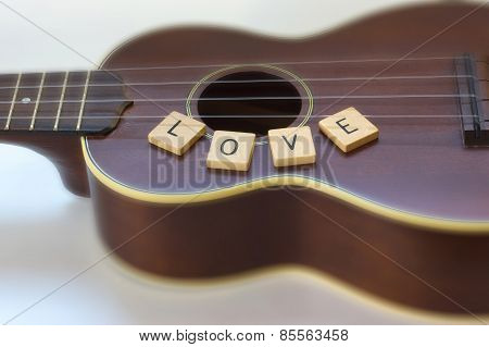 Ukulele with soft focus on Love