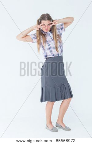 Geeky hipster dancing on white background