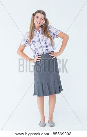 Geeky hipster with hands on hips on white background