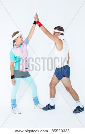 Geeky hipster couple in sportswear on white background