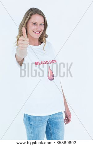 Blood donor showing thumbs up on white background