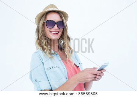 Smiling woman texting with her smartphone on white background
