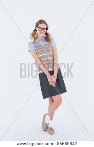 Geeky hipster woman smiling at camera on white background