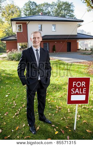 Estate Broker Standing Outside The House
