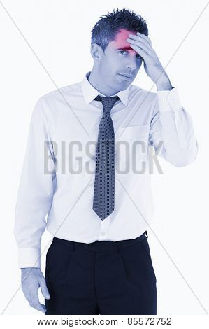 Portrait of a sad business manager with his hand on his forehead against a white background