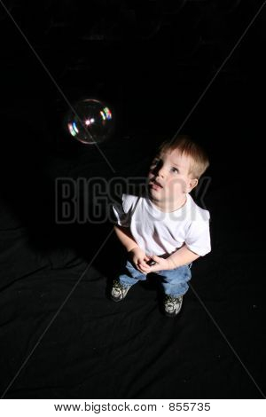 Boy looking at bubble