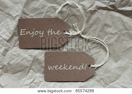 Two Brown Labels With Quote Enjoy The Weekend Paper Background