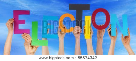 Many People Hands Holding Colorful Word Election Blue Sky